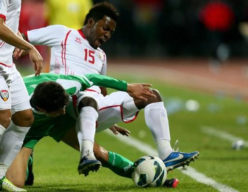 Dhurgham Ismael (C) of Iraq vies with Ismail Salem (R) of UAE during the 21st Gulf Cup's final between United Arab Emirates (UAE) and Iraq on January 18, 2013 in Manama. United Arab Emirates won 2-1 a