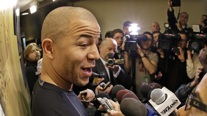 Pittsburgh Penguins' Jarome Iginla, left,  meets the media outside the Penguins locker room before an NHL hockey game against the New York Islanders in Pittsburgh Saturday, March 30, 2013. (AP Photo/Gene  J. Puskar)