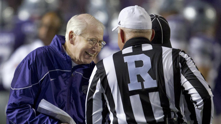 Kansas State coach Bill Snyder, left, talks with referee Cooper Castleberry during the first half of an NCAA college football game against Oklahoma State in Manhattan, Kan., Saturday, Nov. 3, 2012. (AP Photo/Orlin Wagner)