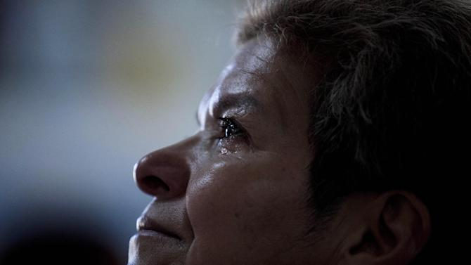 Blanca Franco cries as she attends Mass in the Villa 21-24 slum in Buenos Aires, Argentina, Sunday, March 17, 2013. Villa 21-24 is a slum so dangerous that most outsiders don't dare enter, but residents say Jorge Mario Bergoglio often showed up unannounced to share laughs and sips of mate, the traditional Argentine herbal tea shared by groups using a common straw. Bergoglio was chosen as leader of the Catholic Church on March 13, 2013, and chose the name Francis. (AP Photo/Natacha Pisarenko)