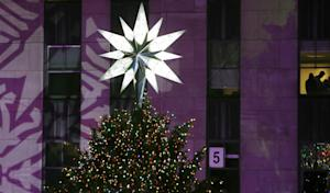 The Swarovski star shines atop the Rockefeller Center …