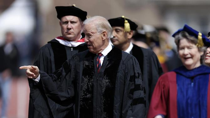 Vice President Joe Biden gestures as he walks onto the field before giving the commencement address at the University of Pennsylvania's 257th Commencement, Monday, May 13, 2013, in Philadelphia. (AP Photo/Matt Rourke)