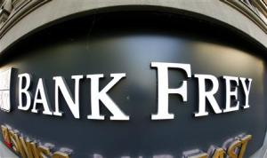 The logo of Swiss Bank Frey & Co. is pictured at the entrance of an office building in Zurich