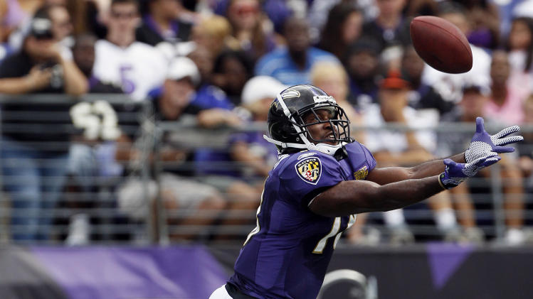 Baltimore Ravens wide receiver Terrell Zachery leaps for a catch during NFL football training camp in Baltimore, Saturday, Aug. 6, 2011. (AP Photo/Patrick Semansky)