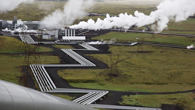 In this July 28, 2011 photo, giant ducts carry superheated steam from within a volcanic field to the turbines at Reykjavik Energy's Hellisheidi geothermal power plant in Iceland. Scientists in the CarbFix experiment will separate carbon dioxide from the steam and pump it underground to react with porous basalt rock, forming limestone, to see how well the gas most responsible for global warming can be locked away in harmless form. (AP Photo/Brennan Linsley)