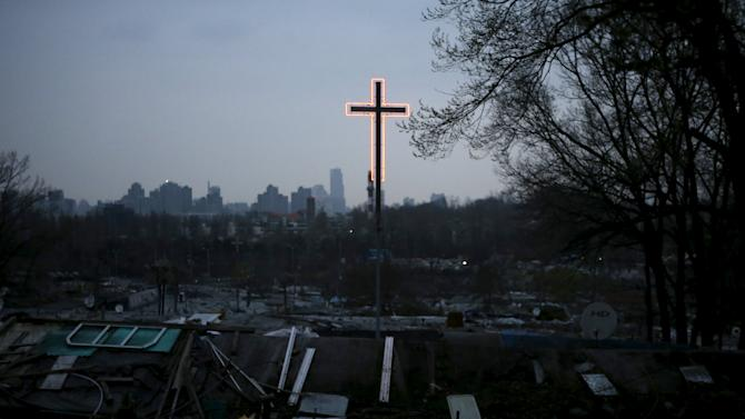 A cross is illuminated at Guryong village in Seoul