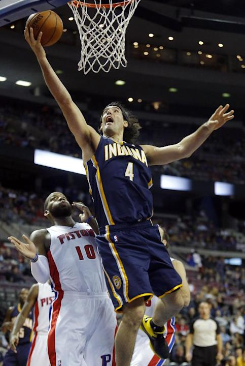 Indiana Pacers forward Luis Scola (4) goes to the basket past Detroit Pistons center Greg Monroe (10) during the first half of an NBA basketball game Tuesday, Nov. 5, 2013, in Auburn Hills, Mich