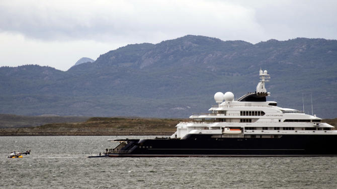 FILE - In this Monday, Jan. 31, 2011 file photo, an helicopter floats on the water close to the Octopus yacht, owned by Microsoft's co-founder Paul Allen, at Ushuaia port, some 3,300 km, about 2045 miles, south of Buenos Aires, Argentina. Allen's mega-yacht - and perhaps even the billionaire himself - are part of a flotilla scouring the Pacific for an American pilot and two Palau police officers whose plane disappeared over the weekend. (AP Photo/Alejandro Madril, File)