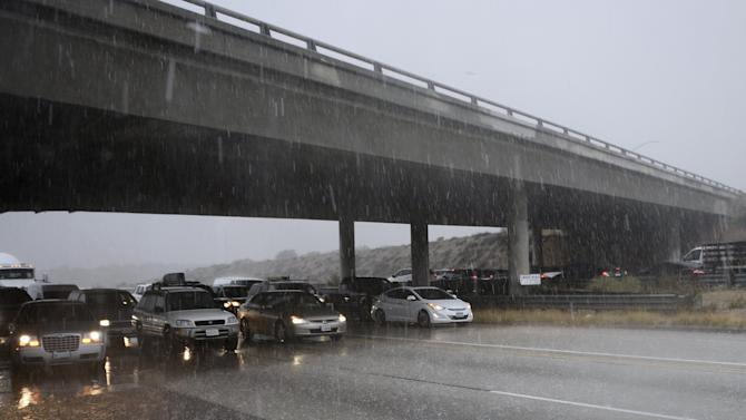 Drivers on the 14 Freeway come to stop as monsoon storm cell dumps hail and rain in the high desert area of Los Angeles County