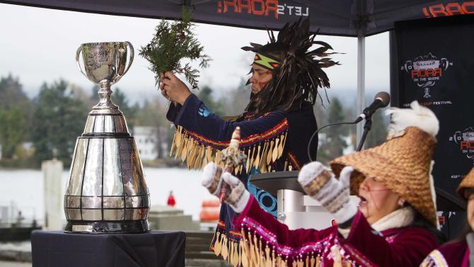 Alex Dan of the Musqueam first nation performs a traditional blessing on the Grey Cup in Vancouver