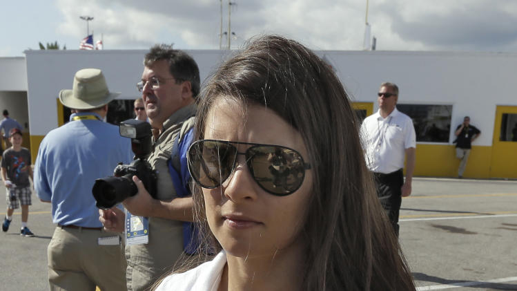 Daytona 500 pole sitter Danica Patrick walks through the garage area during a NASCAR Sprint Cup Series auto racing practice Saturday, Feb. 23, 2013, at the Daytona International Speedway in Daytona Beach, Fla. (AP Photo/Chris O'Meara)