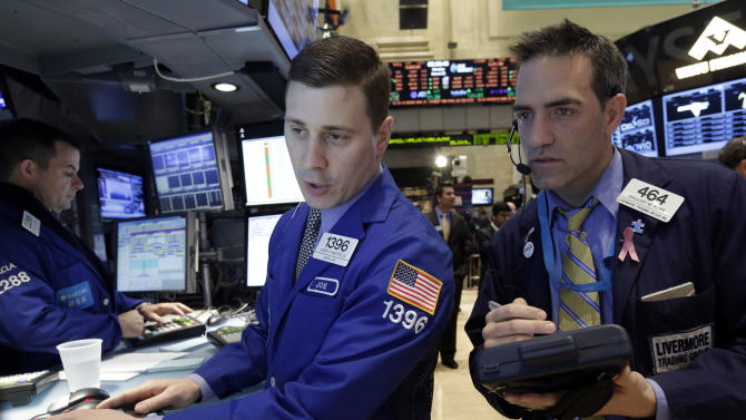 Specialist Joseph Mastrolia, left, and trader Gregory Rowe work on the floor of the New York Stock Exchange Monday, March 25, 2013. U.S. stock markets opened higher after Cyprus clinched a last-minute bailout that saved it from bankruptcy. (AP Photo/Richard Drew)