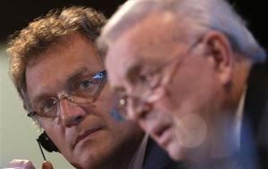 Valcke looks on as Marin talks during a news conference in Rio de Janeiro