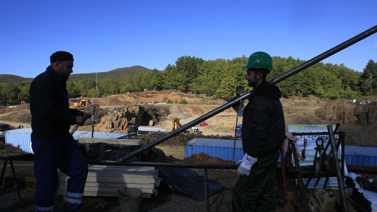 In this Thursday, Oct. 11, 2012, file photo, workers are seen in a gold mine complex in Skouries, in the Halkidiki peninsula in northern Greece. Mining company Hellas Gold expects the mine to be up and running by mid 2015 creating about 2000 jobs for the next five years. But while some see the gold mine seen as a savior _ as Greece enters a sixth year of recession amid record-high unemployment _ others revile it as an environmental catastrophe that will do little to help the economy.  (AP Photo/Nikolas Giakoumidis)