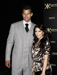FILE - In this Aug. 17, 2011 file photo, reality TV personality Kim Kardashian, right, and her fiance, NBA basketball player Kris Humphries, arrive at the Kardashian Kollection launch party in Los Angeles. Kardashian and Humphries are expected to wed on Saturday, Aug. 20, 2011 in Montecito, Calif. (AP Photo/Matt Sayles, file)