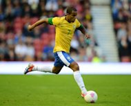 Brazilian midfielder Lucas Moura controls the ball during the London 2012 Olympic games warm up football match between Great Britain and Brazil at the Riverside stadium in Middlesbrough, north-east England on July 20. Manchester United manager Sir Alex Ferguson has confirmed his interest in Lucas
