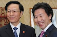 <p>Japanese Finance Minister Jun Azumi (R), pictured with his Chinese counterpart Xie Xuren prior to their meeting at the finance ministry in Tokyo, on April 7. Azumi and Xie have agreed to cooperate over contributions to the International Monetary Fund amid efforts to help subdue Europe's sovereign debt crisis.</p>