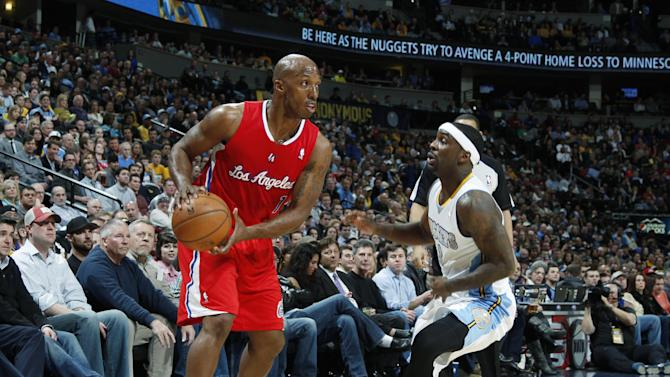 Los Angeles Clippers guard Chauncey Billups, left, looks to pass the ball as Denver Nuggets guard Ty Lawson covers in the first quarter of an NBA basketball game in Denver, Thursday, March 7, 2013. (AP Photo/David Zalubowski)