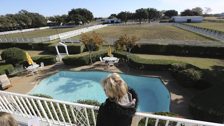 "Shown in this photo made Tuesday, Nov. 13, 2012, is the backyard pool of the mansion at Southfork Ranch made famous by the Dallas TV  show in Parker, Texas. Tourists have been flocking to Southfork Ranch since the early years of the classic series, which ran from 1978 to 1991. And a new ""Dallas"" starting its second season on TNT on Monday and the recent death of the show's star, Larry Hagman, who legendarily played conniving Texas oilman J.R. Ewing, have also spurred fans to visit. (AP Photo/LM Otero)"