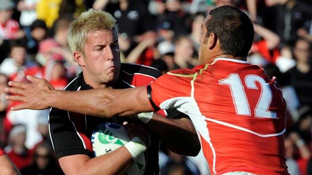 Japan's Ryan Nicholas (R) tackles Canada's DTH van der Merwe during their Rugby World Cup Pool A match at McLean Park in Napier