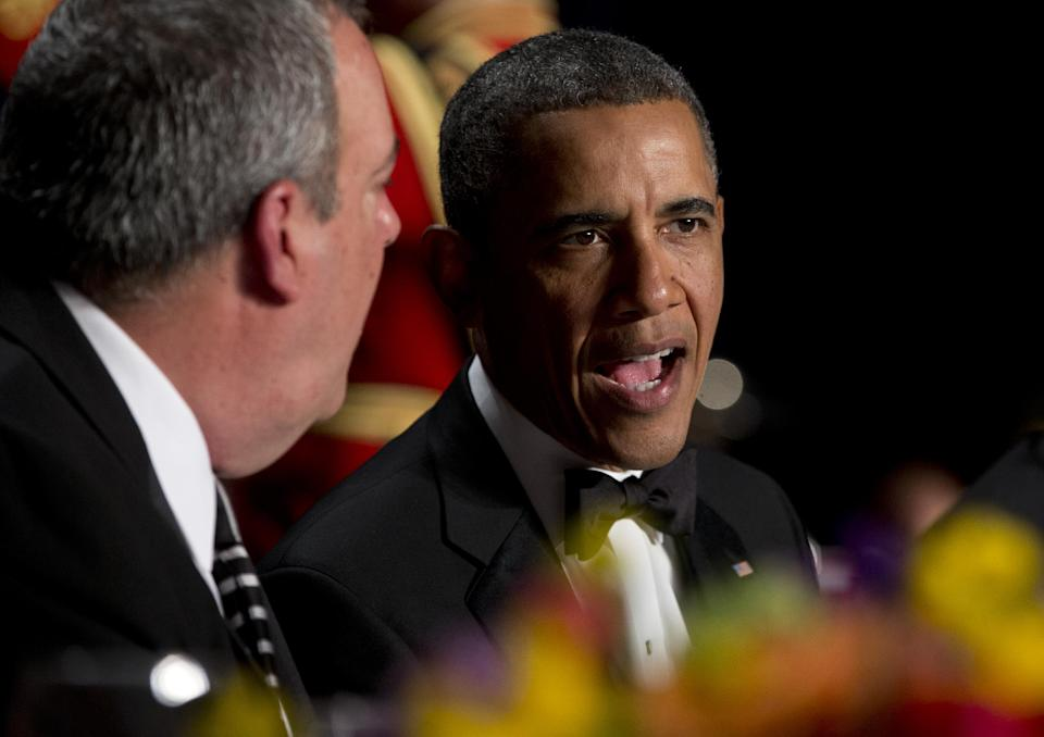 President Barack Obama talks with Michael Clemente, Executive Vice President of Fox News, the White House Correspondents' Association Dinner at the Washington Hilton Hotel, Saturday, April 27, 2013, in Washington.  (AP Photo/Carolyn Kaster)