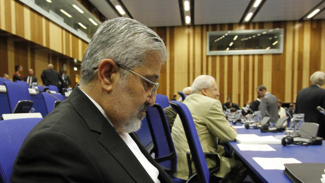 Iran's Ambassador to the International Atomic Energy Agency, IAEA, Ali Asghar Soltanieh reads a  news report on a tablet PC as he waits for the start of the IAEA board of governors meeting at the International Center, in Vienna, Austria, on Monday, June 4, 2012. (AP Photo/Ronald Zak)