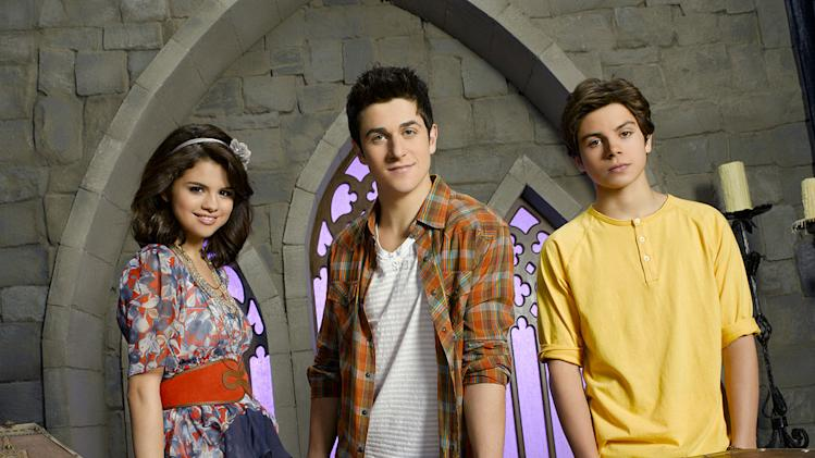 "Selena Gomez as Alex Russo, David Henrie as Justin Russo, and Jake T. Austin as Max Russo on ""Wizards of Waverly Place."""