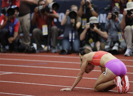 Shannon Rowbury celebrates finishing the women's 1500 meters at the U.S. Olympic Track and Field Trials Sunday, July 1, 2012, in Eugene, Ore. (AP Photo/Matt Slocum)