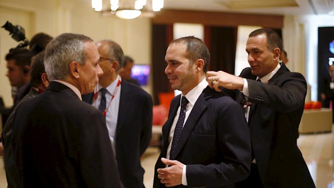 Jordan's Prince Ali Bin Al Hussein (2nd R) clothes are adjusted before the opening of the Soccerex Asian Forum at the King Hussein Convention Center at the Dead Sea, Jordan