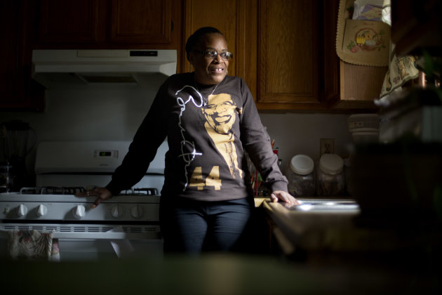 This Jan. 2, 2013, photo, shows Victoria Wimberley, who will be attending President Barack Obama's inauguration for the second time, standing in the kitchen of her home in Decatur, Ga. Four years and