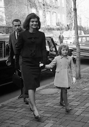FILE - In this Dec. 6, 1963 file photo, Jacqueline Kennedy and her daughter, six-year-old Caroline, arrive at their new home in the Georgetown section of Washington two weeks after her husband was slain in Dallas, Texas. An ABC special with never-before-heard interviews with Jacqueline Kennedy will air Sept. 13. Viewers will hear the former first lady speak with historian Arthur Schlesinger Jr. about life in the White House and with her husband, President John F. Kennedy. The recordings were made months after the president's 1963 assassination and sealed until now. (AP Photo/Bob Schutz, file)