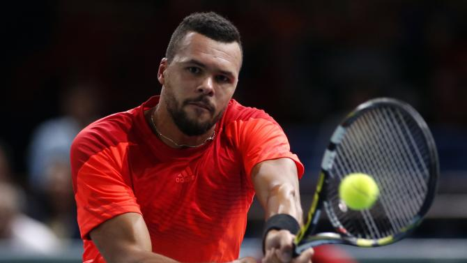 Tsonga of France returns a shot during his men's singles tennis match against Nishikori of Japan in the third round of the Paris Masters tennis tournament at the Bercy sports hall in Paris