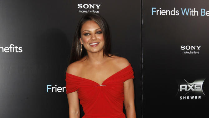 "Cast member Mila Kunis poses at the premiere for ""Friends With Benefits"" in New York City"