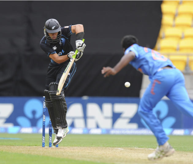 New Zealand's Ross Taylor bats off the bowling of India's Varun Aaron in the fifth and final one-day international cricket match in Wellington, New Zealand, Friday, Jan. 31, 2014. (AP Photo/SNPA,