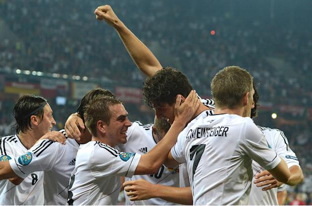 German Forward Mario Gomez (C),German Midfielder Bastian Schweinsteiger (R) And German Forward Thomas Mueller Celebrate  AFP/Getty Images