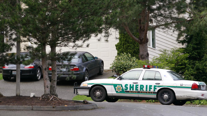 A sheriff's car is parked in a woodsy suburban area adjacent to a wilderness area and nearby trail access several miles from where a gun-toting survivalist is suspected of killing his wife and daughter several days earlier Friday, April 27, 2012, in North Bend, Wash. Peter Alex Keller may be holed up in a self-made fort not far from where Seattle's outer suburbs give way to the vast recreational playground of Cascade Mountains. Police expect more people to hit the nearby trails this weekend, and deputies are warning them to steer clear of Keller if they think they see him.  (AP Photo/Elaine Thompson)