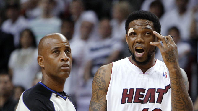 Miami Heat's Udonis Haslem (40) reacts after being called for a flagrant foul against Indiana Pacers' Tyler Hansbrough during the first half of Game 5 of an NBA basketball Eastern Conference semifinal playoff series, in Miami on Tuesday, May 22, 2012. At left is referee Derrick Stafford. (AP Photo/Lynne Sladky)