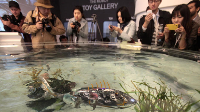 FILE - In this Friday, April 20, 2012 file photo, a fish robot swims at the Marine Robot Pavilion of the EXPO 2012 in Yeosu, South Korea. The Expo 2012 will open for three months on May 12 in Yeosu with a theme focused on the ocean. Its formal theme is