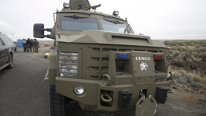 An armored vehicle sits at a FBI roadblock on the road leading to the headquarters to the Malheur National Wildlife Refuge outside Burns, Oregon