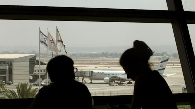 A plane belonging to Israel's national airline El Al sits on the tarmac of Ben Gurion International airport, near Tel Aviv, on July 23, 2014