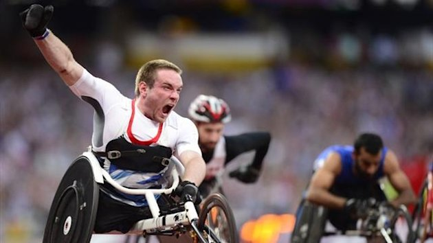Mickey Bushell wins 100m wheelchair sprint gold at the London 2012 Paralympics (AFP)