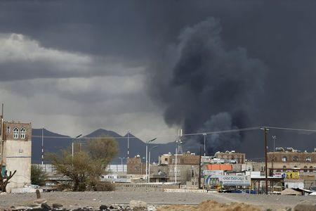 Smoke billows after an air strike hit the international airport of Yemen's capital Sanaa