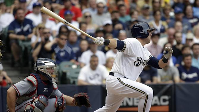 Milwaukee Brewers' Caleb Gindl hits a single during the sixth inning of a baseball game against the Atlanta Braves Saturday, June 22, 2013, in Milwaukee. The hit was Gindl's first major league career hit. (AP Photo/Morry Gash)