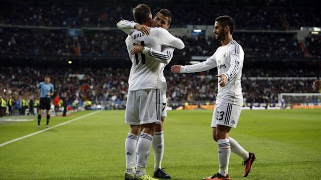 Real Madrid's Gareth Bale (L) celebrates scoring against Sevilla with teammates Cristiano Ronaldo and Isco (Reuters)