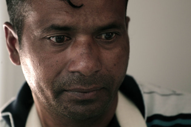 Indian migrant worker Nermal Chand, who was attacked at his home by masked men near Athens, at a news conference organized by anti-racism campaigners in Athens, Thursday, July 19, 2012. Human rights groups say racially motivated attacks have soared in Greece in recent months. The extreme right Golden Dawn party won 18 seats in parliament in elections last month. It denies direct involvement in the attacks. (AP Photo/Dimitri Messinis)