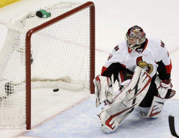 Ottawa Senators goalie Anderson lets in a goal by Penguins' Malkin during the second period in Game 5 of their NHL Eastern Conference semi-final hockey series in Pittsburgh