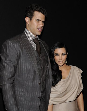 FILE - In this Aug. 31, 2011 file photo, newlyweds Kim Kardashian and Kris Humphries attend a party thrown in their honor at Capitale in New York. Attorneys for Kardashian and Humphries are due in a Los Angeles courtroom on Friday, Feb. 15, 2013 to argue over a trial date to end the couples 72-day marriage. Humphries is seeking to delay the case until after the NBA season is over, while Kardashian wants the marriage ended as soon as possible. (AP Photo/Evan Agostini, File)