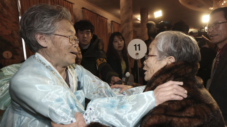 South Korean Kim Sung-yoon, 96, right, meets with her North Korean sister Kim Seok Ryu, 80, during the Separated Family Reunion Meeting at Diamond Mountain resort in North Korea, Thursday, Feb. 20, 2014. The rival nations struck a deal last week to go ahead with brief meetings of war-divided families, though there's wariness in Seoul that Pyongyang could back out again. As they waited anxiously in the days leading up to the trip, many elderly Koreans had been unsure whether they would be able to see their long-lost relatives' faces before they die. (AP Photo/Yonhap, Lee Ji-eun) KOREA OUT
