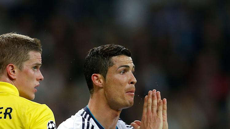 Real Madrid's Cristiano Ronaldo from Portugal, center, reacts during the Champions League semifinal second leg soccer match between Real Madrid and Borussia Dortmund at the Santiago Bernabeu stadium in Madrid, Spain, Tuesday April 30, 2013. (AP Photo/Paul White)