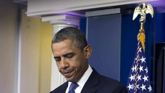 President Barack Obama arrives to make a statement on the fiscal cliff negotiations with congressional leaders in the briefing room of the White House on Friday, Dec. 28, 2012, in Washington. The negotiations are a last ditch effort to avoid across-the-board first of the year tax increases and deep spending cuts.  (AP Photo/ Evan Vucci)